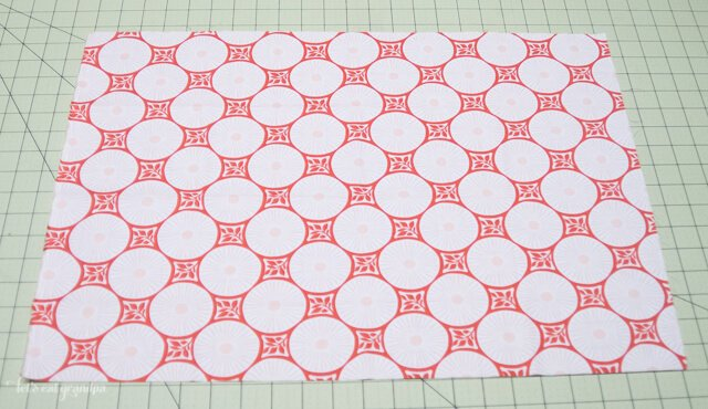 Piece of fabric on cutting mat to make pillow envelope enclosure
