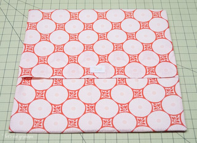 Fabric on cutting mat to make pillow envelope closure