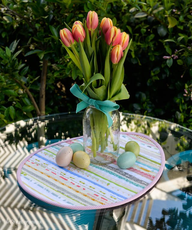 Easter Selvage Table Topper with vase of tulips