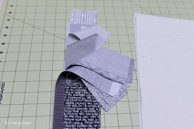strips of gray fabric for QAYG tutorial