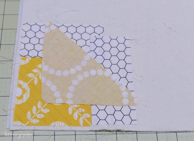 fabric strips placed on batting fabric to make Northwest QAYG
