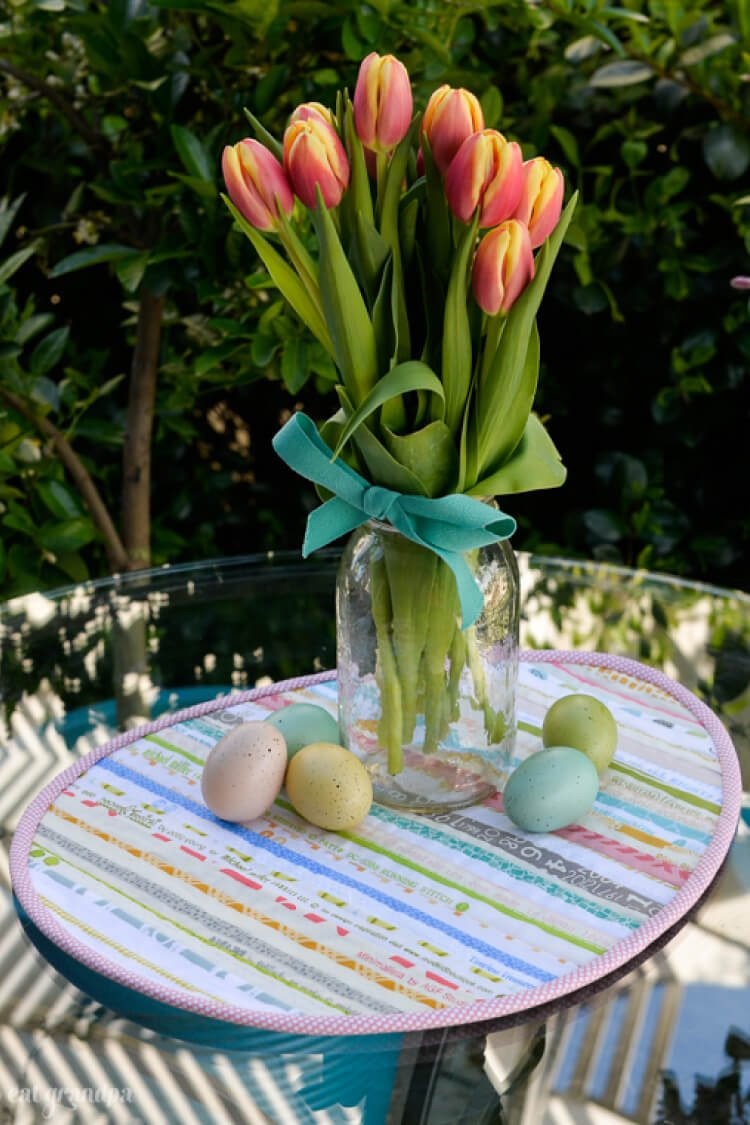 Sew a sweet Easter table topper in the shape of an Easter egg, using up your leftover selvages! A great scrapbuster sewing project.