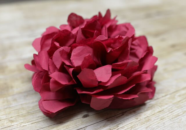 Tissue paper flowers make a gorgeous budget wedding centerpiece. Learn how to make four different types of tissue paper flowers!