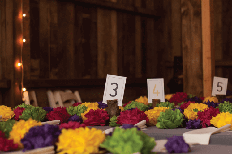 finished paper tissue flowers at tables at wedding