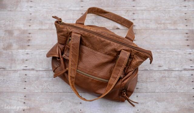 Brown handbag on wooden ground