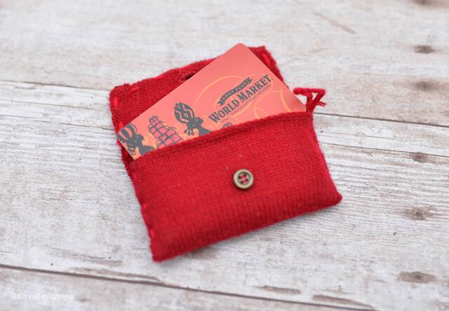 gift cards peeking through a red purse