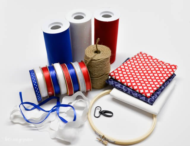 supplies needed to make a patriotic windsock - red, white, and blue ribbon, fabric, hoop, and twine