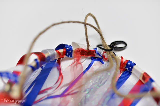 twine attached to hoop to make patriotic windsock with red, white, and blue ribbon