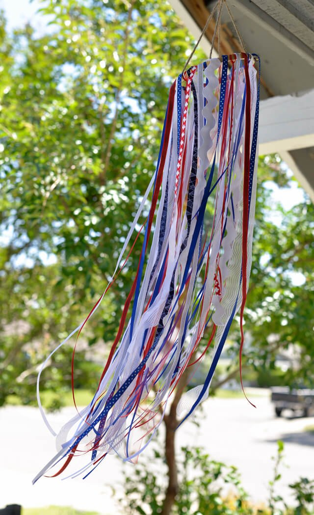 finished patriotic windsock hanging from house outside