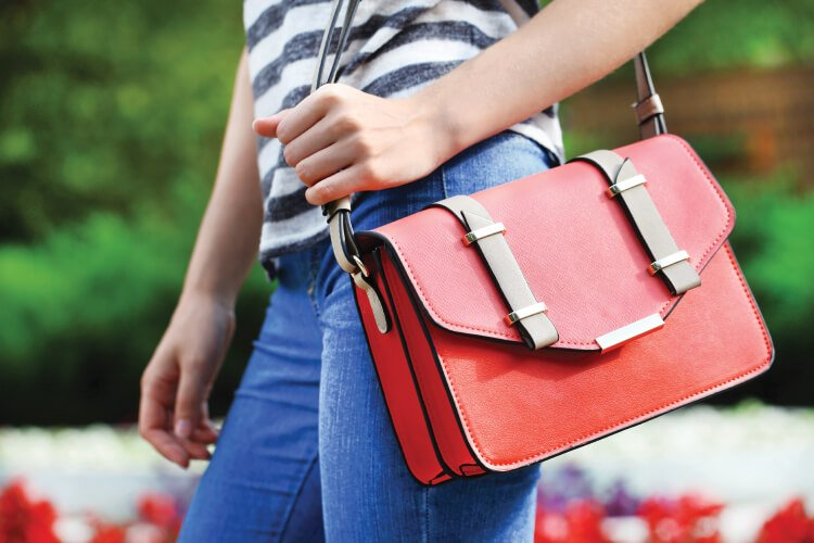 side view of woman holding red purse