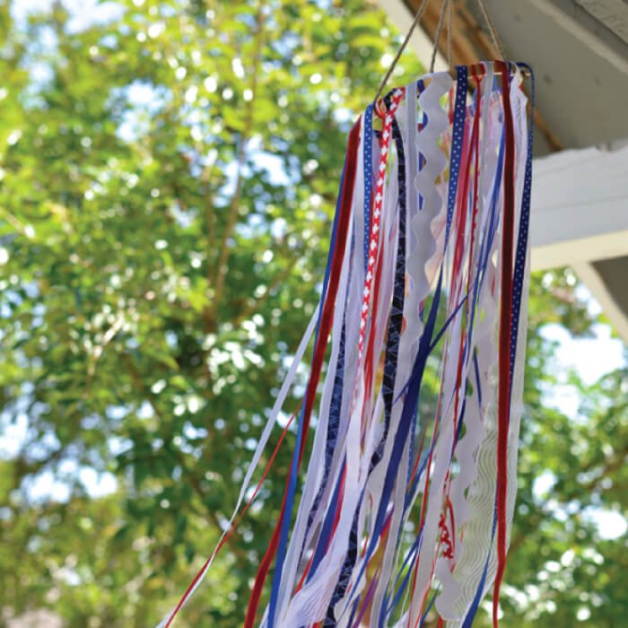 Use ribbon and other scraps to make this patriotic windsock! It's the perfect outdoor decor for the 4th of July and Memorial Day. A great scrapbusting project!