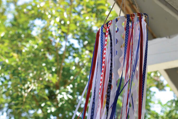 red, white and blue hanging windosck