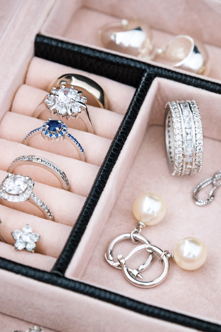 Do you find tangled necklaces and lone earrings taking over your jewelry box? Here's how to clean out your jewelry box, declutter what you don't need, and wear what you love.