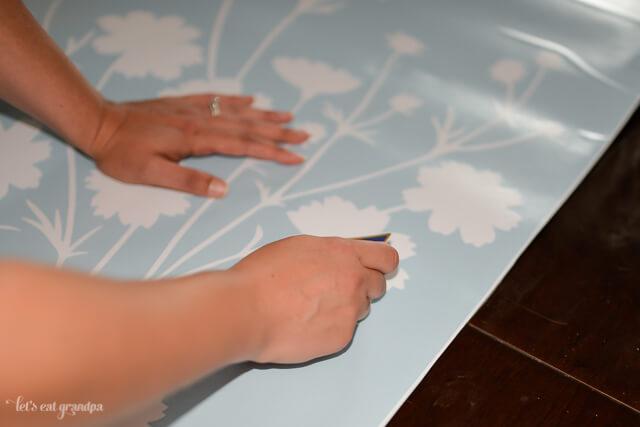 hands adding floral decals