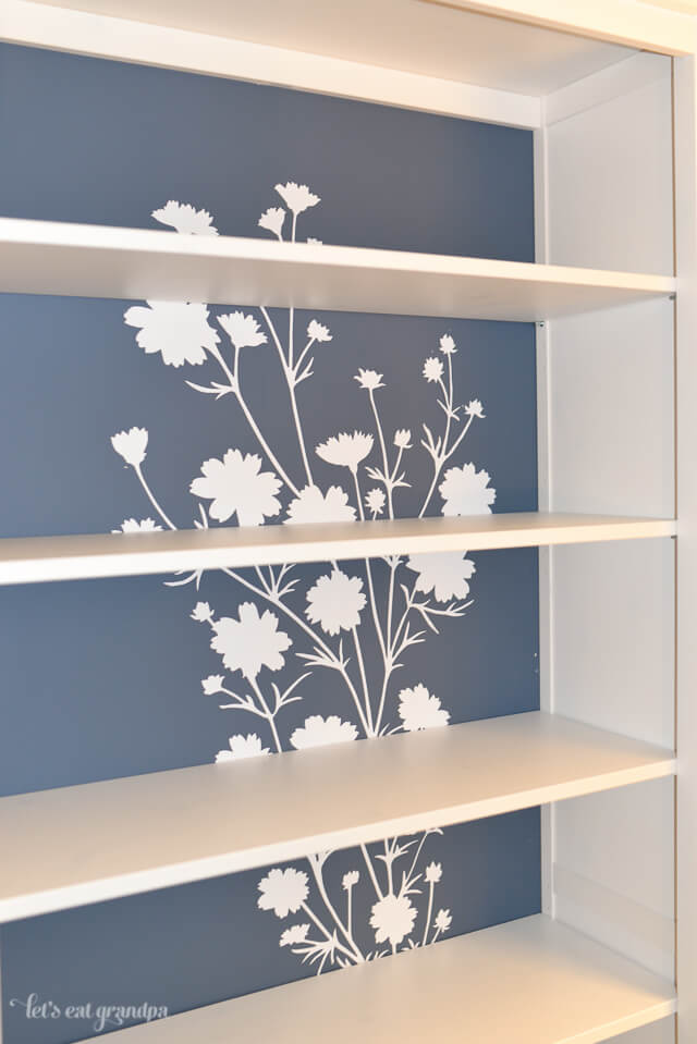 finished bookshelf with floral decal