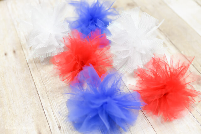 red, white, and blue firework poofs from tulle