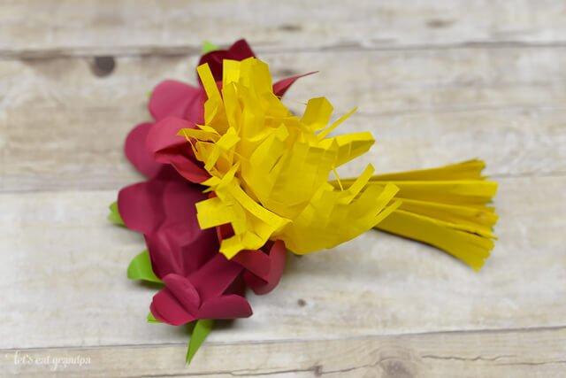 magenta, yellow, and green tissue paper flower fluffed out a bit