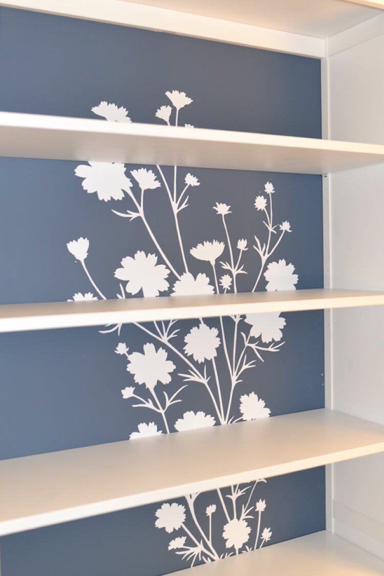 Turn a plain IKEA bookshelf into a custom piece of furniture using paint and decals! A fun IKEA hack to personalize your decor using Wallternatives decals.