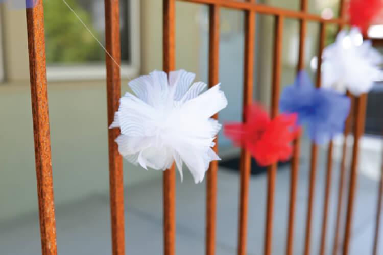 DIY tulle fireworks strung across gate