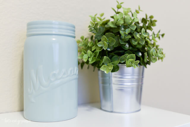 closeup of green plant and blue vase