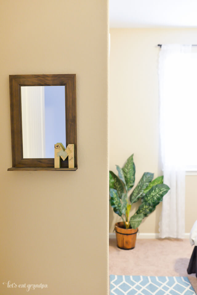 mirror and plant in guest bedroom