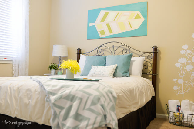 pretty bed in guest room makeover