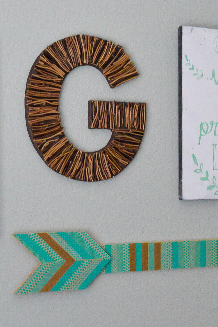 Take a hike and collect some found objects, like sticks and feathers. Then make a personalized initial!