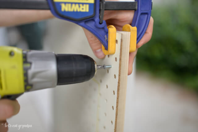 drilling screws in pegboard to mount
