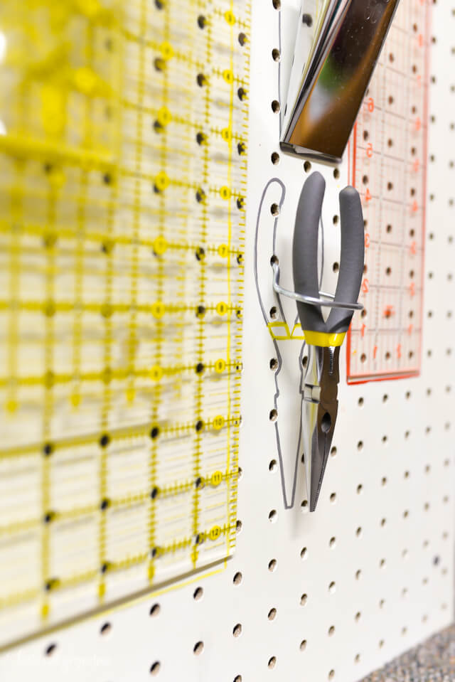 craft tools hanging from pegboard with colorful sharpie outline behind them