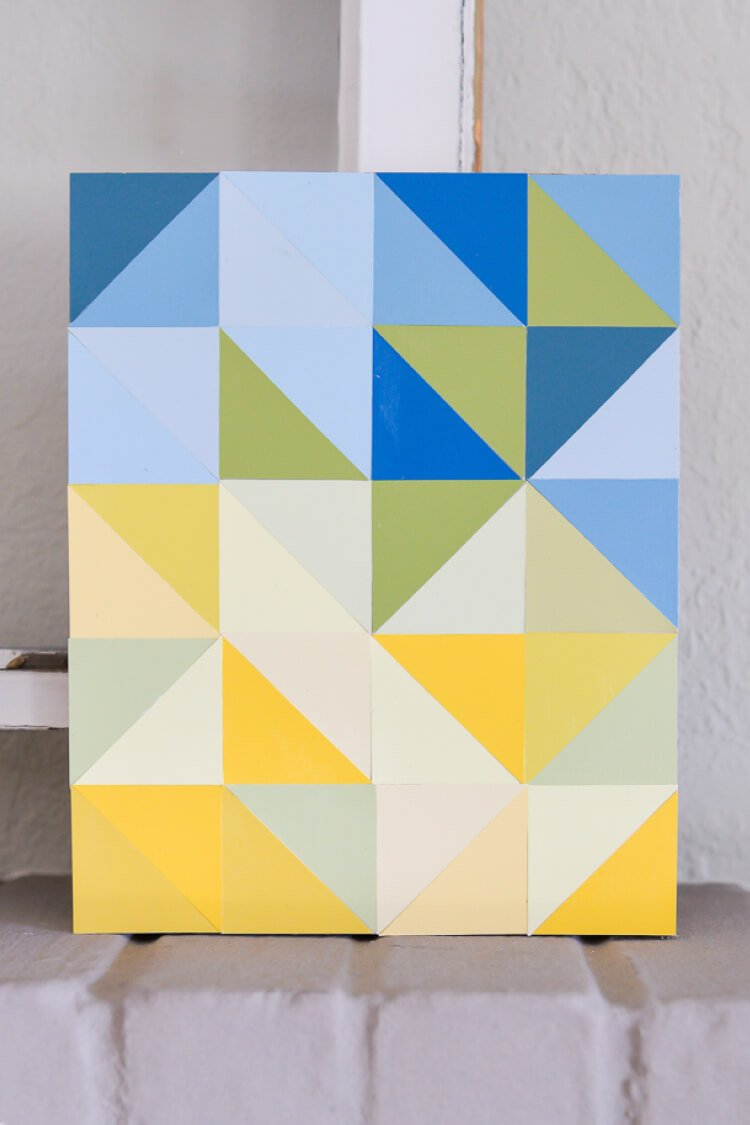 This DIY paint chip artwork is a fun way to use paint chips after you're done using them to choose paint colors. An easy craft that makes modern home decor!