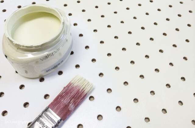 paint and paintbrush to paint pegboard white