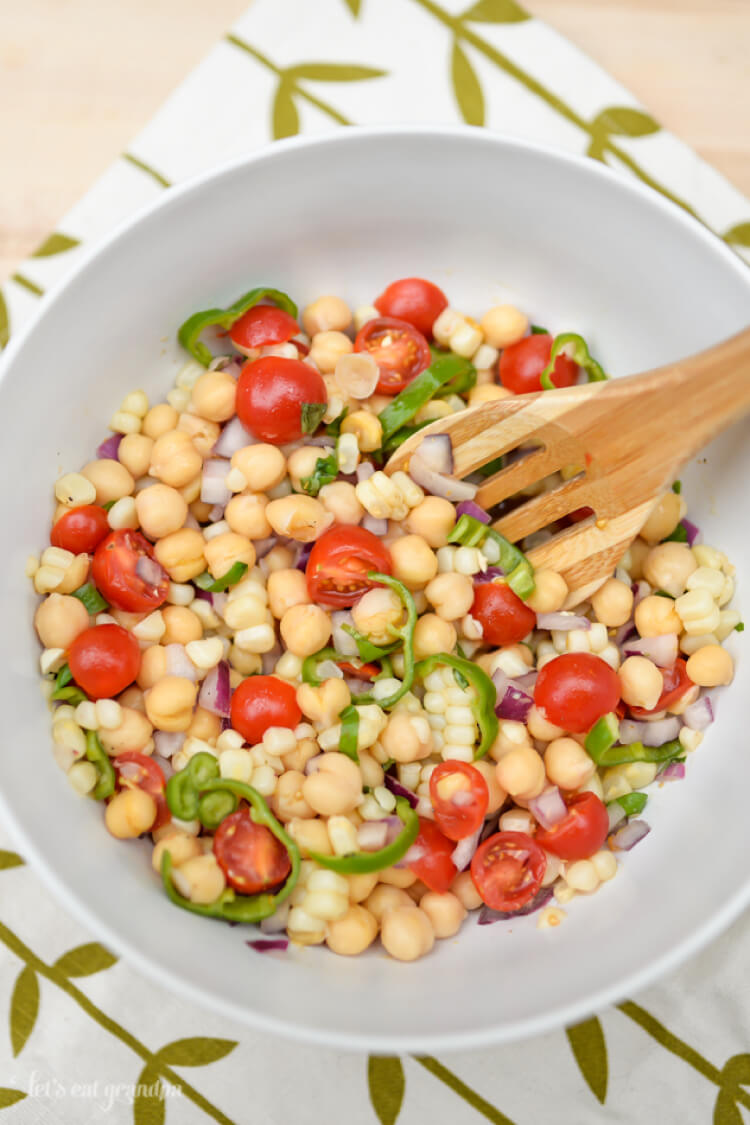 This easy summer salad is the perfect side dish to bring to any barbecue! Spice it up a bit with shishito peppers and a tangy dressing -- this is a dish that will delight!