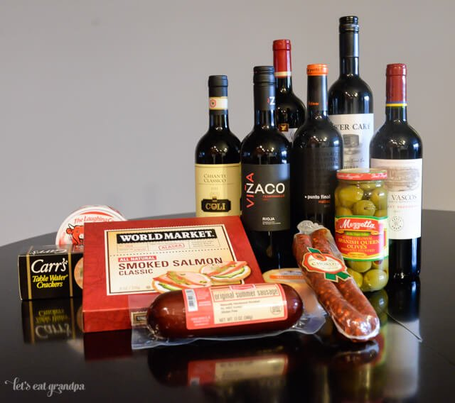 red wines, salami, olives, and smoked salmon for wine party