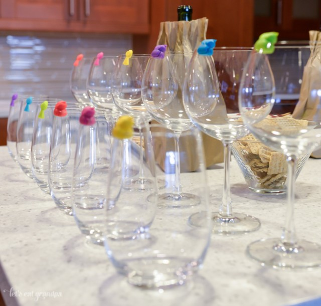 stemmed and stemless glasses lined on counter