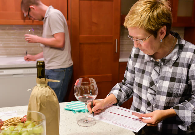 woman filling out form at wine tasting party