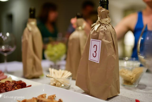 wine in brown bags with numbered labels