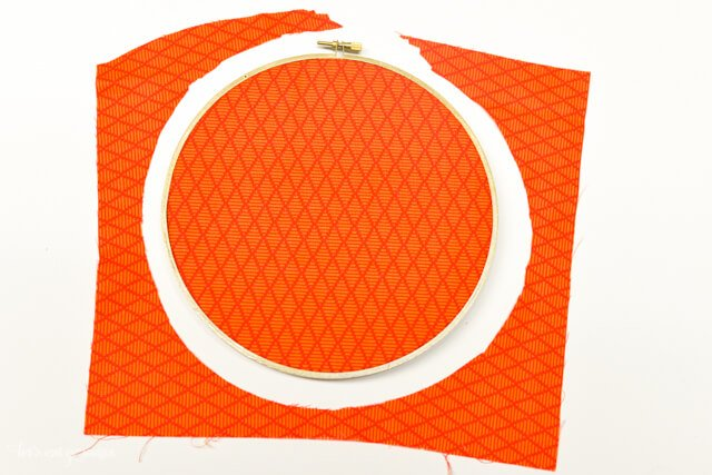 orange fabric covering embroidery hoop