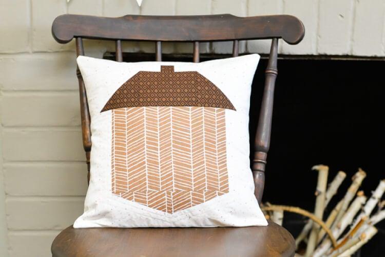 acorn quilt block pillow on rocking chair