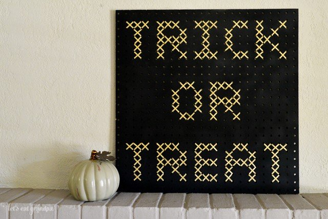 Make this giant cross stitch using a pegboard and ribbon!