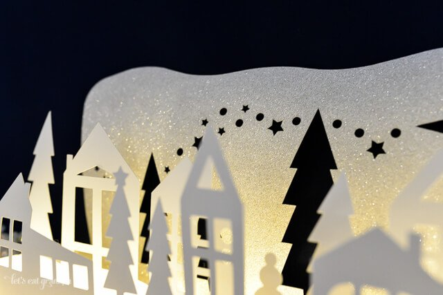 This gorgeous winter wonderland luminaria is a beautiful decoration on your Christmas mantel or table! Cut using your Cricut or other cutting machine and add fairy lights so it glows!