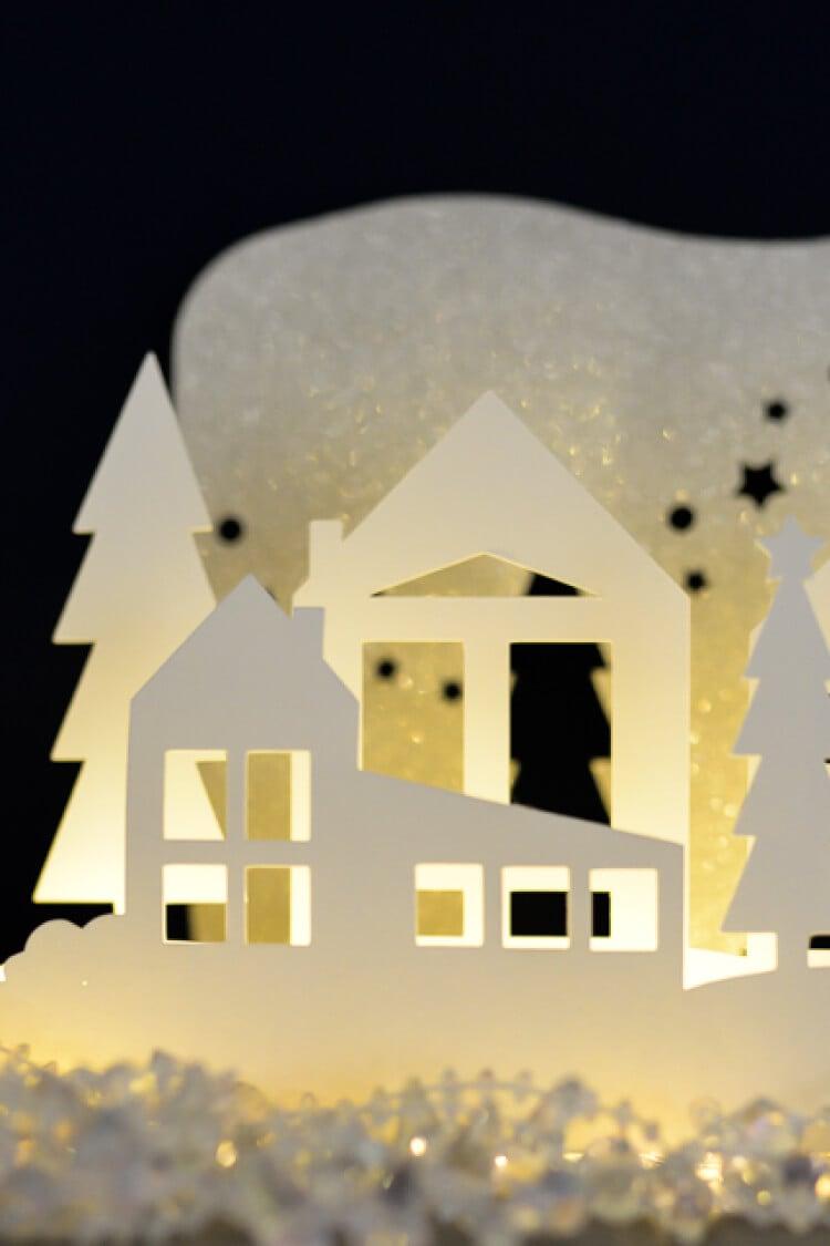 This winter wonderland mantel luminaria was cut on the Cricut Explore. A beautiful Christmas decoration.
