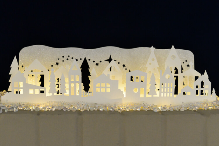 This winter wonderland mantel luminaria was cut on the Cricut Explore. A beautiful Christmas decoration.