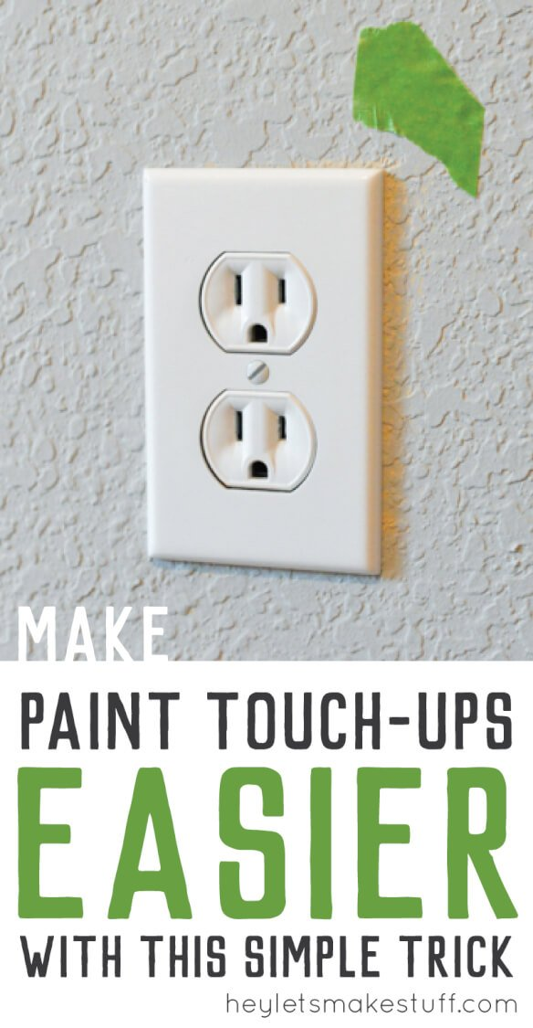 Pin image of wall outlet with green painter's tape on wall