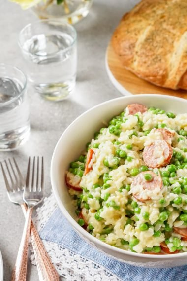 This easy weeknight dinner, Polska Kielbasa Casserole with Peas and Rice, is real comfort food, and perfect for potlucks!