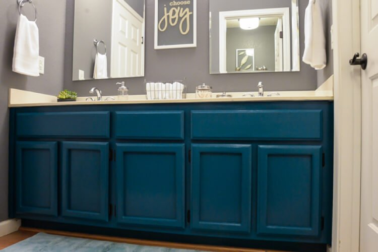 finished 1980s bathroom makeover with teal cabinets