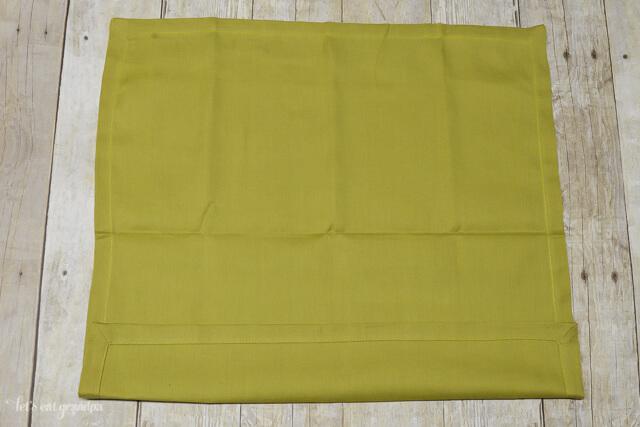 green napkin folded 1/4