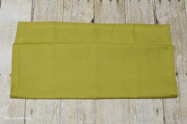 green napkin folded almost in half