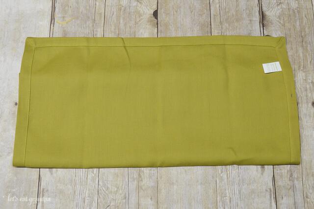 green napkin folded in half