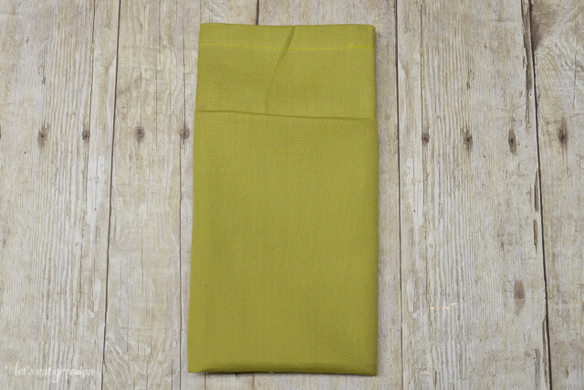 green napkin folded with a pocket