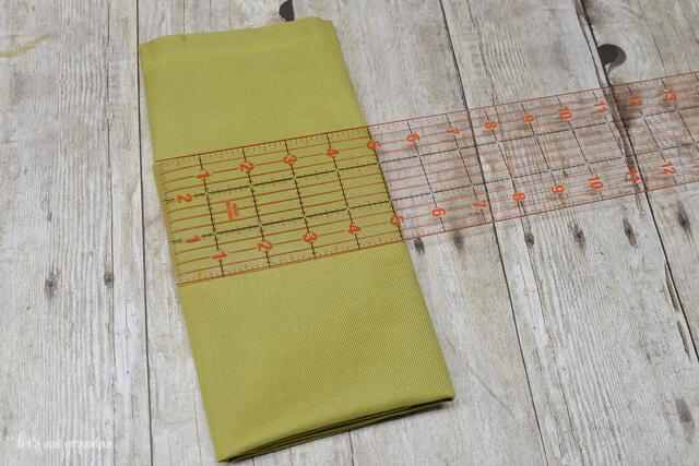 ruler on green folded napkin
